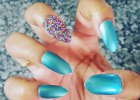 Love this aquamarine shade and I added some Essence nail caviar to it